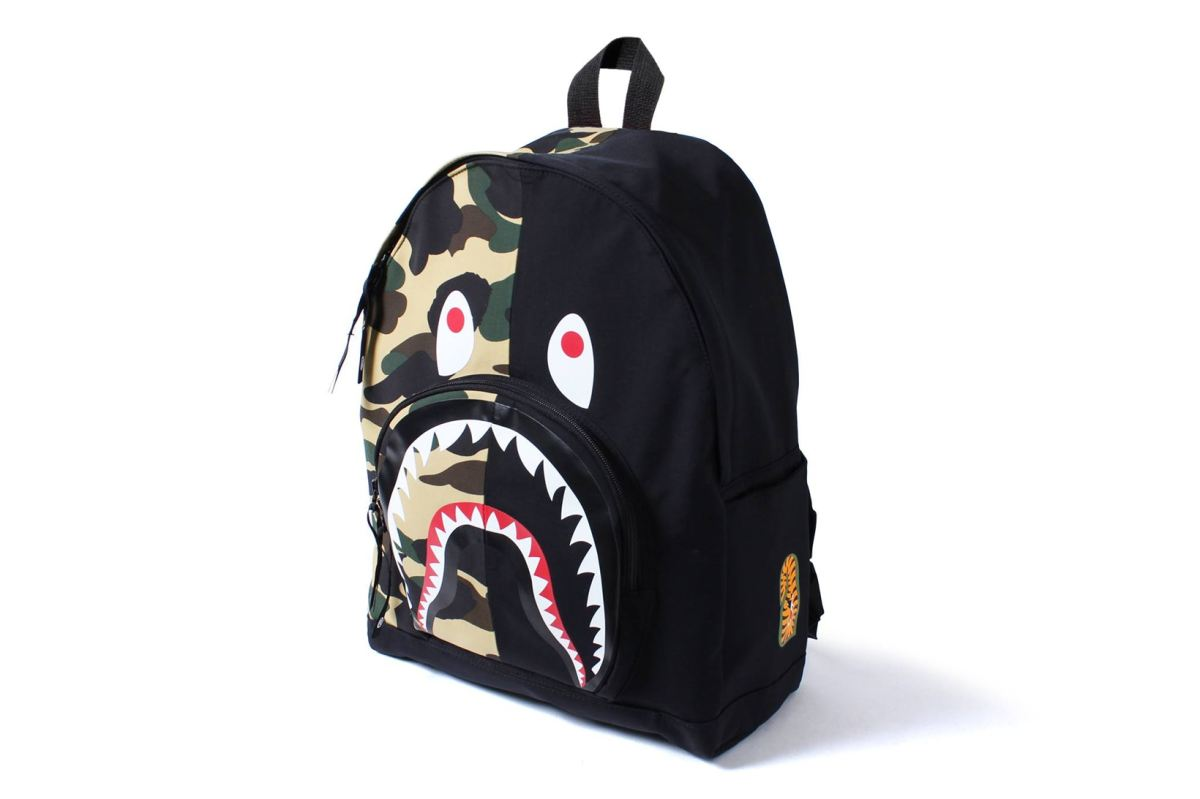 BAPE RELEASES FIRST CAMO SHARK TRAVEL BAG